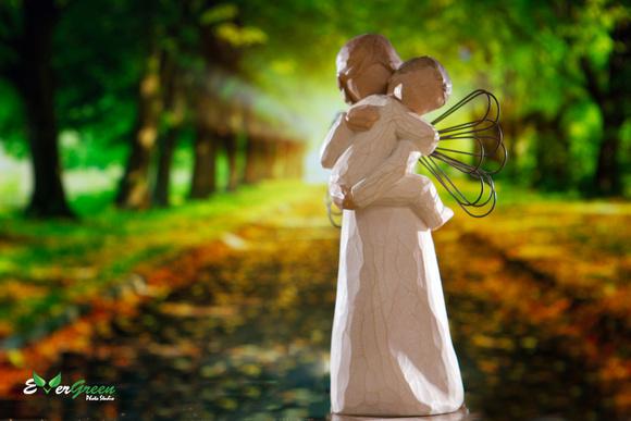 Embracing Willow Tree® sculptures