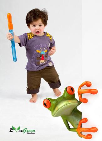 little boy running after a frog